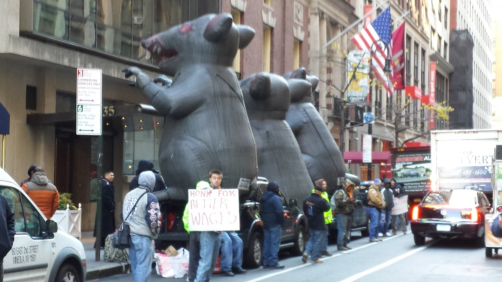 Photo of three Local 79 rats on street