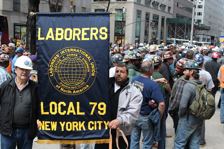 Photo of Local 79 Banner and workers at Memorial Mass